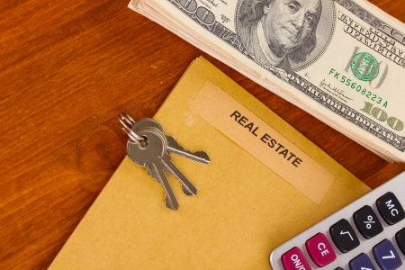 business law: folder with information of real estate on wooden background close-up