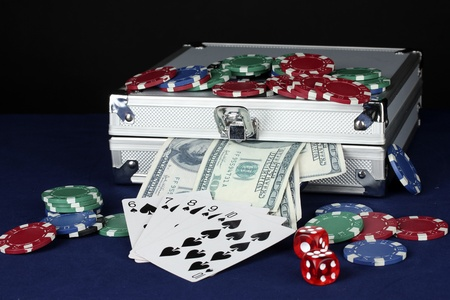 Suitcase with dollars on the blue poker table photo