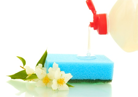 bright sponge and flowers  with dish washing liquid isolated on white photo