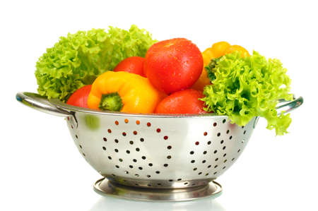 fresh vegetables in silver colander isolated on white Stock Photo - 14606747