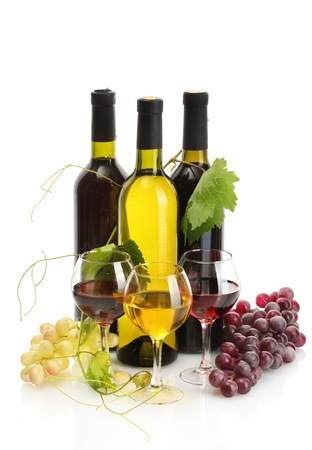 bottles and glasses of wine and ripe grapes isolated on white