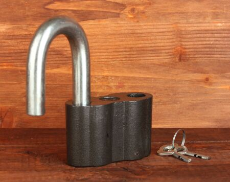 old padlock with keys on wooden background close-up Stock Photo - 14607776