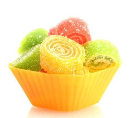 sweet jelly candies in cup cake case isolated on white  photo