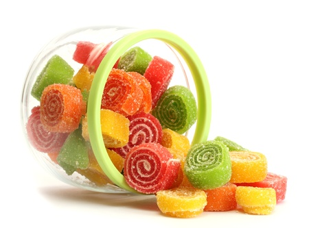 colorful jelly candies in glass jar isolated on white  Stock Photo