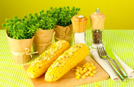boiled corn with butter and spices photo