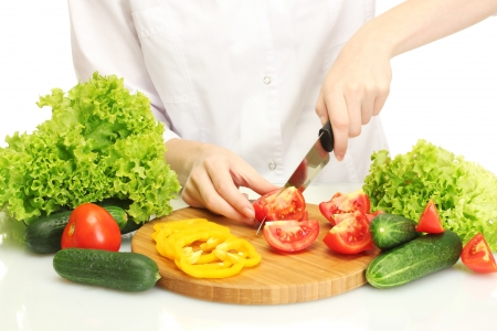 woman hands cutting vegetables on kitchen blackboard photo
