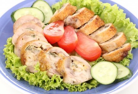 Tasty meat cutlet with garnish on plate close-up photo