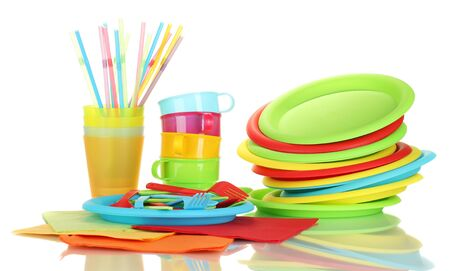 bright plastic disposable tableware isolated on white background photo