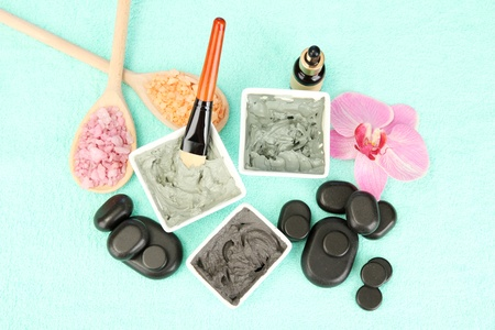 cosmetic clay for spa treatments on blue background close-up photo