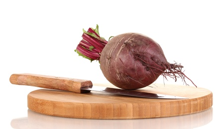 Young red beet on wooden board isolated on white photo