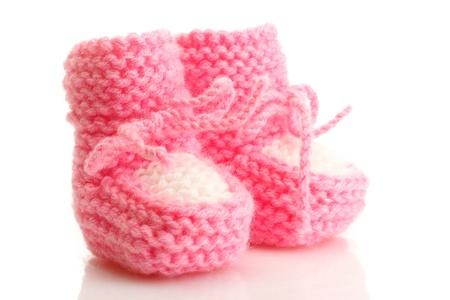 cuddly baby: pink baby boots isolated on white
