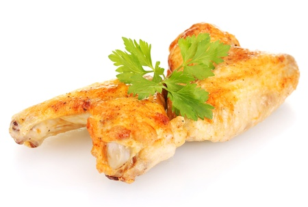 roasted chicken wings with parsley isolated on white photo