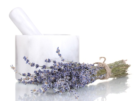 Lavender flowers with mortar isolated on white photo