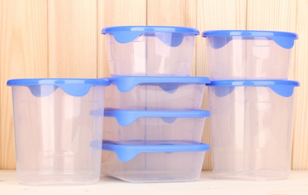 Plastic containers for food on wooden background photo