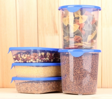 storage box: Filled plastic containers on wooden background