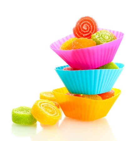 bonbons: sweet jelly candies in cup cake cases isolated on white