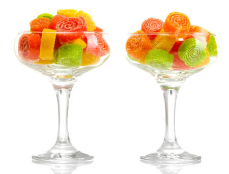 colorful jelly candies in  in cocktail glasses isolated on white  photo