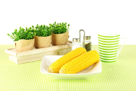 boiled corn and flowers on a white background photo