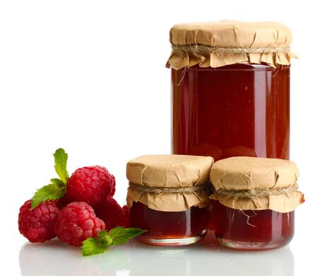 jars with jam and ripe raspberries with mint isolated on white photo