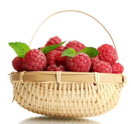 ripe raspberries in basket with mint  isolated on white Stock Photo - 14692273