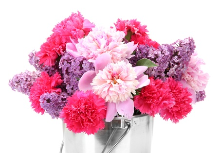 beautiful spring flowers in metal bucket isolated on white Stock Photo - 14706439