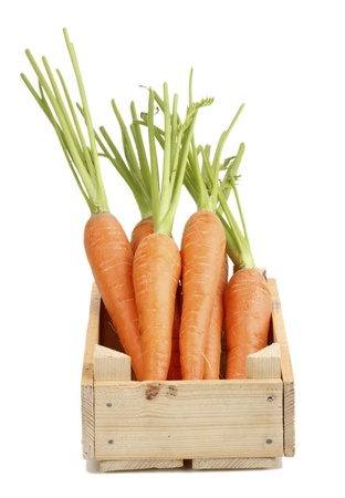 ingredient: Carrots in crate isolated on white