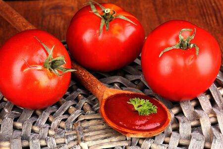 Ripe tomatoes on wooden table close-up photo