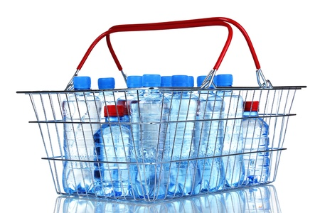 plastic bottles of water in metal basket isolated on white photo