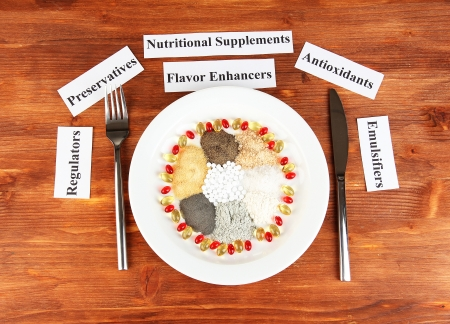 enhancer: Nutritional supplements on wooden background close-up Stock Photo