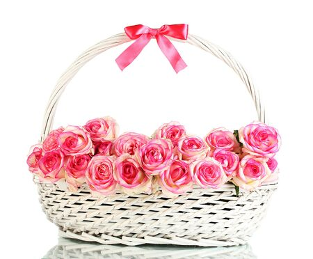 beautiful bouquet of pink roses in basket, isolated on white photo