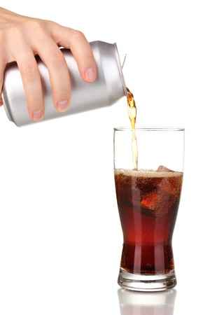 Pouring cola into glass isolated on white  photo