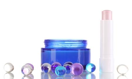 Hygienic lipstick and moisturizing cream isolated on white Stock Photo