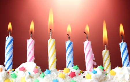 birthday cakes: beautiful birthday candles  on red background Stock Photo