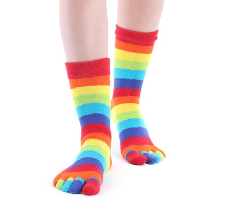 long socks: female legs in colorful striped socks isolated on white Stock Photo