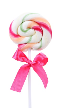Colorful lollipop with bow isolated on white photo