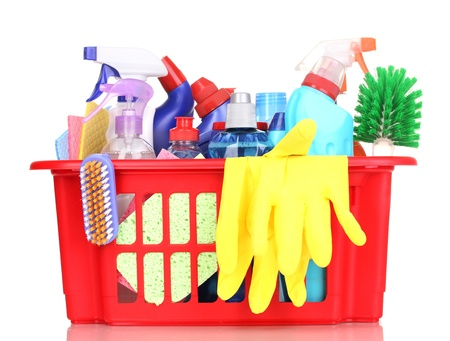 house chores: Cleaning items in plastic basket isolated on white Stock Photo
