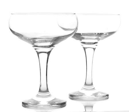 empty glasses of champagne isolated on a white photo