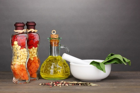 Set of ingredients and spice for cooking on wooden table on grey background photo