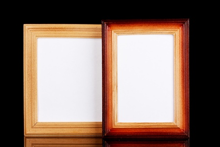 Wooden frames isolated on black photo