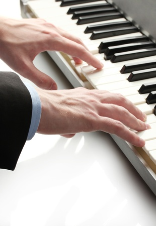 hands of man playing piano Stock Photo - 14746660