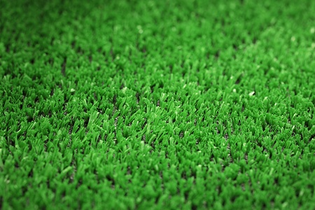 backgrounnd of artificial green grass photo