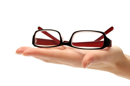 opthalmology: glasses on female hand, isolated on white Stock Photo