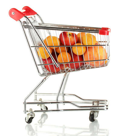 Ripe fruit in metal trolley isolated on white photo