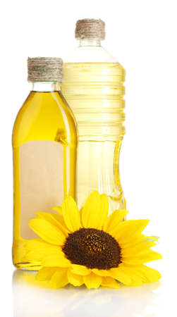 oil in jars and sunflower, isolated on white photo