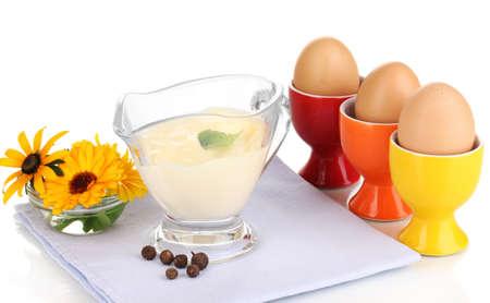 Mayonnaise in bowl on napkin isolated on white photo