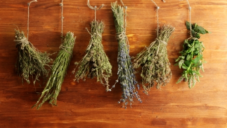 dried herbs, on wooden background photo