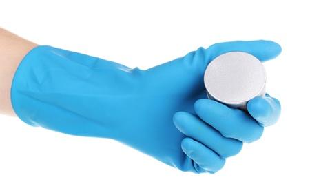 Uranium in hand isolated on white photo