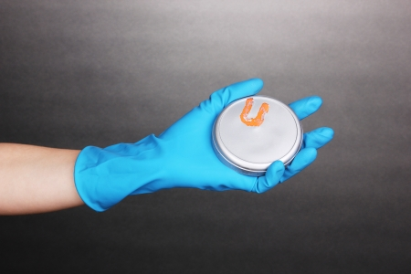 Uranium in hand on grey background Stock Photo - 14746138