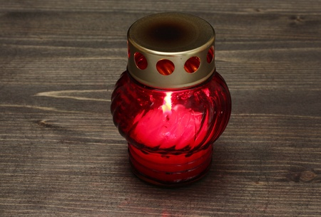 Memory lantern with candle on wooden background photo