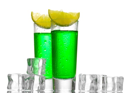 glasses of absinthe, ice and lime isolated on white photo